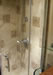 A wetroom with stone tiles by Simon Bailey Building Contractor